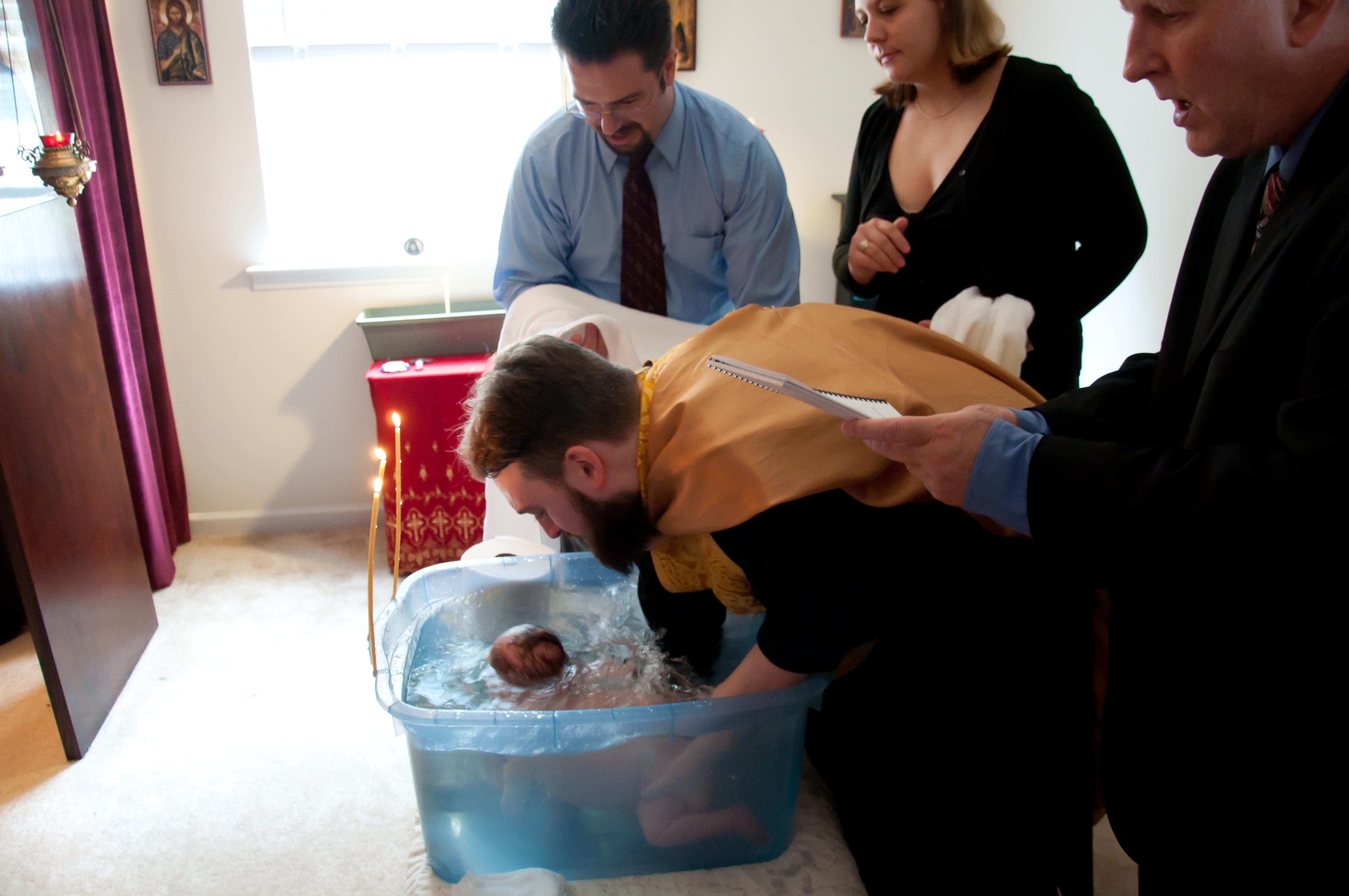Fr. Anastasios Hudson Baptizing His Daughter